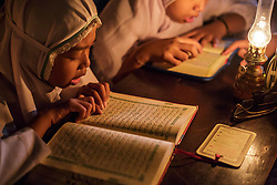 June 11, 2017 - Surakarta, Indonesia - The students of Baitul Mustafa Islamic Boarding School reading the Holy Quran using the oil lamps lighting to celebrate the holy day of Nuzulul Quran in Surakarta, Central Java, Indonesia, on June 11, 2017. Nuzulul Quran is a revelation of the holy Qur'an, which literally means descent of the Qur'an to the earth, events of the first significant decline in the revelation of God to the Prophet Muhammad SAW in the night of 17th of Ramadan. (Credit Image: © Reza Fitriyanto/NurPhoto via ZUMA Press)