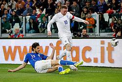 Wayne Rooney of England is challenged by Andrea Ranocchia of Italy - Photo mandatory by-line: Rogan Thomson/JMP - 07966 386802 - 31/03/2015 - SPORT - FOOTBALL - Turin, Italy - Juventus Stadium - Italy v England - FIFA International Friendly Match.