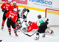Eric Pance and Ales Music of Olimpija vs Jure Pavlic of Jesenice during ice hockey game between Team Jesenice and HDD Telemach Olimpija in 1st leg of Finals of Slovenian National Championship 2014, on March 31, 2014 in Arena Podmezakla, Jesenice, Slovenia. Photo by Vid Ponikvar / Sportida