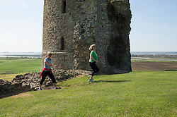 © Licensed to London News Pictures. 16/05/2014. Essex UK. On a fine sunny morning, dog walkers and runners enjoy the weather at Hadleigh Castle overlooking the Thames Estuary. Photo credit : Simon Ford/LNP