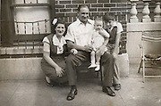 A father and mother posing with two children