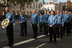 London, UK. 10 November, 2019. Ben Griffin holds a floral wreath of white poppies accompanied by fellow ex-services personnel from Veterans For Peace UK (VFP UK) taking part in the Remembrance Sunday ceremony at the Cenotaph. VFP UK was founded in 2011 and works to influence the foreign and defence policy of the UK for the larger purpose of world peace.