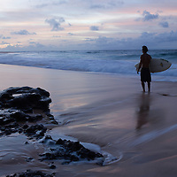 Surfer at Sandy Beach