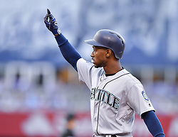 August 3, 2017 - Kansas City, MO, USA - The Seattle Mariners' Jarrod Dyson signals to the dugout after reaching on a single in the second inning against the Kansas City Royals at Kauffman Stadium in Kansas City, Mo., on Thursday, Aug. 3, 2017. Dyson played for the Royals from 2010-16. (Credit Image: © John Sleezer/TNS via ZUMA Wire)