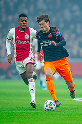 Ryan Gravenberch #29 of Ajax and Sam Lammers #14 of PSV Eindhoven in action during the match between Ajax and PSV at Johan Cruyff Arena on February 02, 2020 in Amsterdam, Netherlands