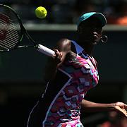 Venus Williams of the United States returns a shot against Caroline Wozniacki of Denmark during their match at the Miami Open tennis tournament at Crandon Park on Monday, March 30, 2015 in Key Biscayne, Florida. Williams won the match. (AP Photo/Alex Menendez)
