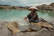 Ropiah (45 years). Works in this mine on the road to Pemali since 8 years. Bangka Island (Indonesia) is devastated by illegal tin mines. The demand for tin has increased due to its use in smart phones and tablets. Most mines are exploited illegally and accidents occur often.<br /> <br /> Ropiah (45 ans). Cherche de l'étain depuis 8 ans, mine d'étain illégale sur la route de Pemali. L'île de Bangka (Indonésie) est dévastée par des mines d'étain sauvages. la demande de l'étain a explosé à cause de son utilisation dans les smartphones et tablettes