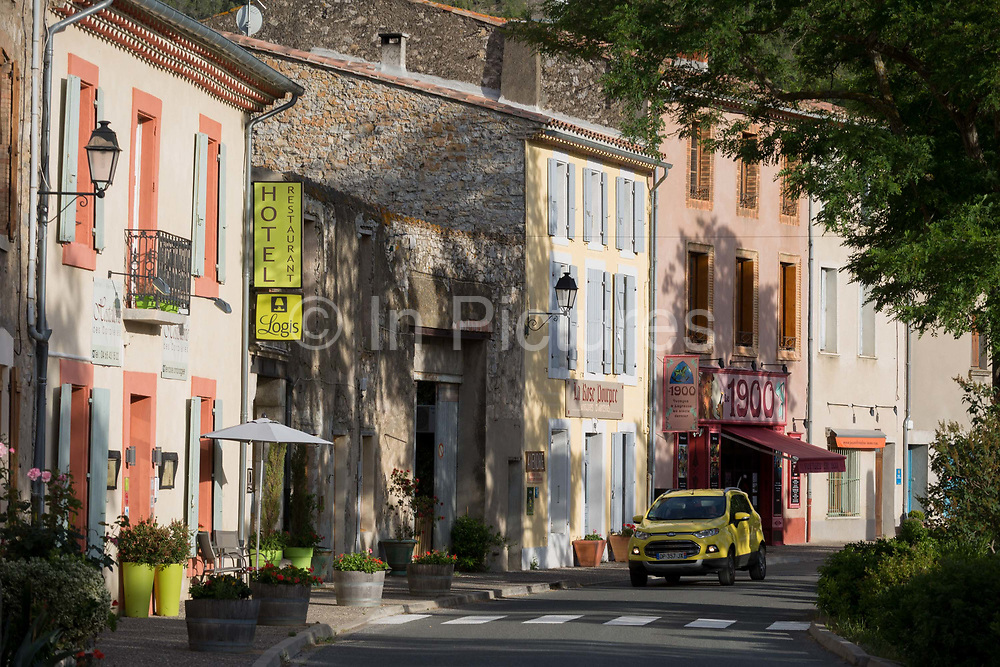 Shops and local businesses on main Le Promenade street, on 21st May 2017, in Lagrasse, Languedoc-Rousillon, south of France. Lagrasse is listed as one of Frances most beautiful villages and lies on the famous Route 20 wine route in the Basses-Corbieres region dating to the 13th century.