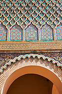 Zellij mosaics and arabesque Moorish plasterwork of the Bab Mansour gate. Named after the architect, El-Mansour, completed in 1732 the design of the gate plays with Almohad patterns. Meknes Morocco .<br /> <br /> Visit our MOROCCO HISTORIC PLAXES PHOTO COLLECTIONS for more   photos  to download or buy as prints https://funkystock.photoshelter.com/gallery-collection/Morocco-Pictures-Photos-and-Images/C0000ds6t1_cvhPo<br /> .<br /> <br /> Visit our ISLAMIC HISTORICAL PLACES PHOTO COLLECTIONS for more photos to download or buy as wall art prints https://funkystock.photoshelter.com/gallery-collection/Islam-Islamic-Historic-Places-Architecture-Pictures-Images-of/C0000n7SGOHt9XWI