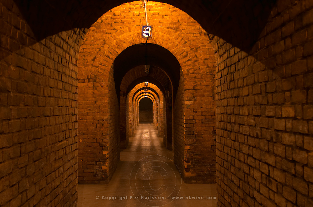 The underground cellars where the wine champagne bottles are stored with vaults and signs with numbers indicating the different locations at Champagne Deutz in Ay, Vallee de la Marne, Champagne, Marne, Ardennes, France