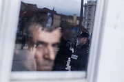 Jan. 24, 2015 - Prishtina, Kosovo - An Albanian hunger-striker, who alongside his friends enters the 244th day of hunger strike, looked throughout the plastic window of his tent the anti-government protesters in Pristina, who later clashed with police. (Credit Image: © Vedat Xhymshiti/ZUMA Wire)