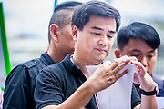 29 NOVEMBER 2013 - BANGKOK, THAILAND: ABHISIT VEJJAJIVA, the former Prime Minister of Thailand, reaches out to supporters at the anti-government protest in front of the US Embassy. Abhisit, who lost the Prime Minister office to Yingluck Shinawatra in the 2011 election in Thailand, is still the leader of the opposition Democrat party. He has been a vocal critic of the government. Several thousand Thai anti-government protestors marched on the US Embassy in Bangkok. They blew whistles and asked the US to honor their efforts to unseat the elected government of Yingluck Shinawatra. The anti-government protestors marched through several parts of Bangkok Friday paralyzing traffic but no clashes were reported, even after a group protestors tried to occupy Army headquarters.       PHOTO BY JACK KURTZ