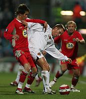 Photo: Paul Thomas.<br /> Blackburn Rovers v Basle. UEFA Cup. 02/11/2006.<br /> <br /> Blackburn's Morten Gamst Pedersen (L) tries to get the ball from Ivan Rakitic (White).