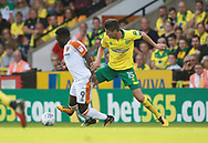 Hull City's Nouha Dicko and Norwich City's Timm Klose during the EFL Sky Bet Championship match between Norwich City and Hull City at Carrow Road, Norwich, England on 14 October 2017. Photo by John Marsh.