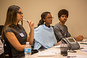 Purchase, NY – 31 October 2014. Early College High School students Jamely Marte, Daniela Amponsah, and Justice Medina listening to a fellow teammember. The Business Skills Olympics was founded by the African American Men of Westchester, is sponsored and facilitated by Morgan Stanley, and is open to high school teams in Westchester County.