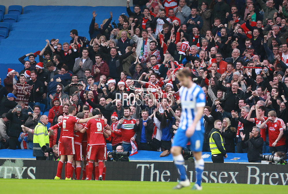 Middlesbrough FC striker Christian Stuani celebrates his goal in front of the travelling support during the Sky Bet Championship match between Brighton and Hove Albion and Middlesbrough at the American Express Community Stadium, Brighton and Hove, England on 19 December 2015. Photo by Bennett Dean.