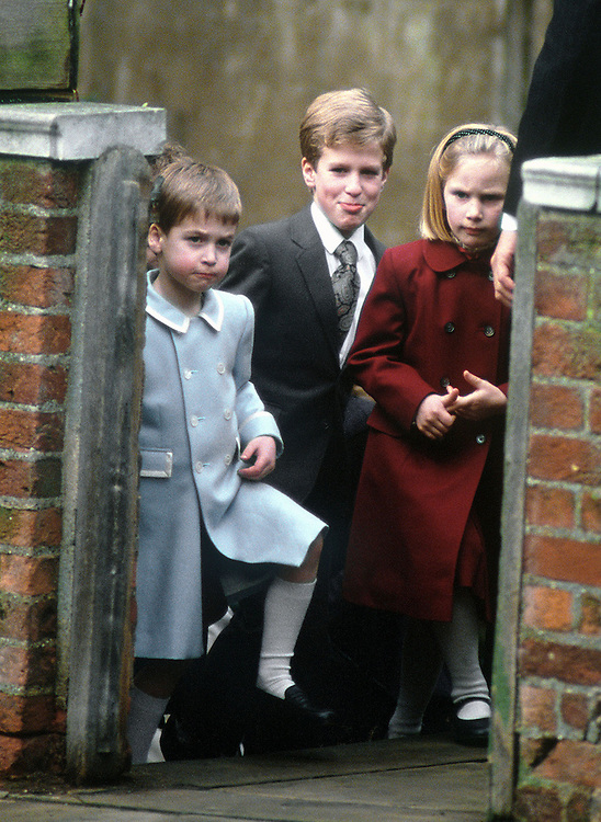 Prince William seen with his cousins Peter and Zara Phillips as they leave the Chapel Royal at Windsor after the Christmas service in December 1987. Photograph by Jayne Fincher