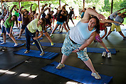 Mackenzie Wolfson, a natural athlete (top left) and accomplished tennis player who plays on her school's varsity softball team goes through the first activity of every day at Camp Shane, a stretching class. (From the book What I Eat: Around the World in 80 Diets.) The caloric value of her typical day's worth of food in July was 1,700 kcals. She is 15; 5 feet nine inches tall,  and 299 pounds.