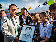 09 JANUARY 2016 - BANGKOK, THAILAND: PRAYUTH CHAN-O-CHA, the Prime Minister of Thailand, is presented with a sketched portrait of him during Children's Day festivities at Government House. National Children's Day falls on the second Saturday of the year. Thai government agencies sponsor child friendly events and the military usually opens army bases to children, who come to play on tanks and artillery pieces. This year Thai Prime Minister General Prayuth Chan-ocha, hosted several events at Government House, the Prime Minister's office.     PHOTO BY JACK KURTZ