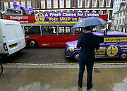 © Licensed to London News Pictures. 26/04/2012. London, UK . Campaign vehicles outside the launch. The UK Independence Party (UKIP) local election campaign launch at St Stephen's Club, Central London. Photo credit : Stephen Simpson/LNP