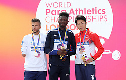USA's Tobi Fawehinmi (centre), Greece's Christos Koutoulias (left) and Japan's Hajimu Ashida with their medals after the Men's Triple Jump T47 Final during day five of the 2017 World Para Athletics Championships at London Stadium.