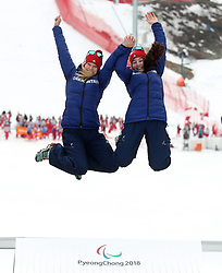 Great Britain's Menna Fitzpatrick (right) and her guide Jennifer Kehoe (left) celebrate winning the Women's Slalom, Visually Impaired at the Jeongseon Alpine Centre during day nine of the PyeongChang 2018 Winter Paralympics in South Korea.
