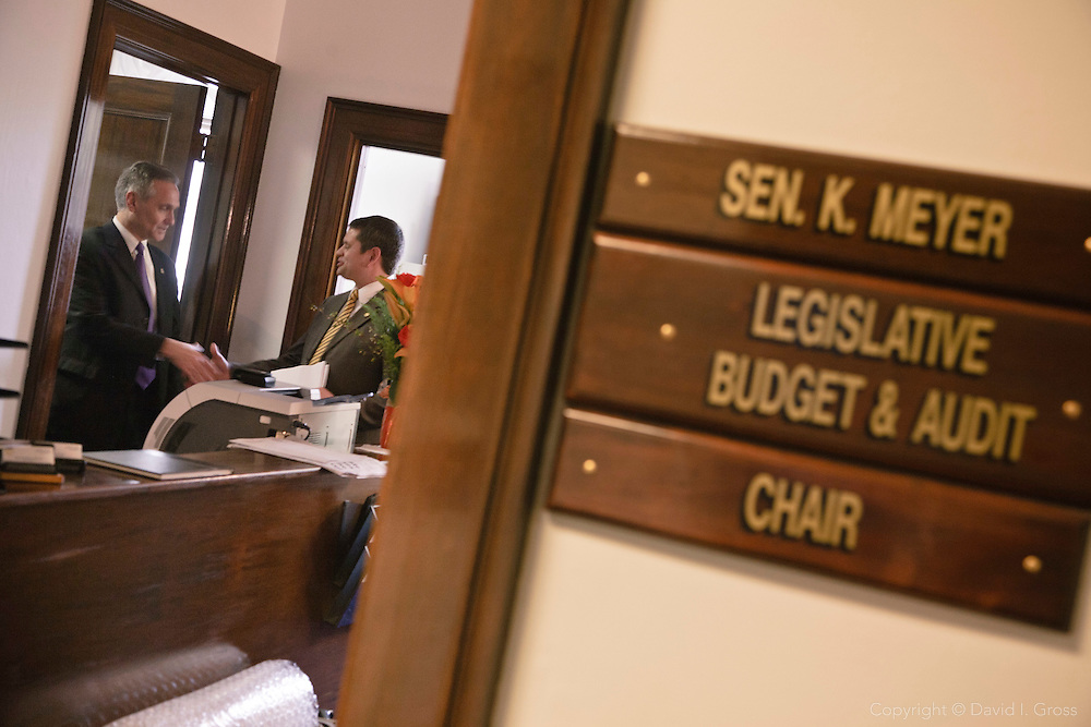 Senator Kevin Meyer (R) concludes a meeting with Rep. Chris Tuck (D) about Tuck's bill in the Alaska State Legislature.