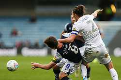 Luke Ayling of Leeds United and Ben Thompson of Millwall tussle for the ball - Mandatory by-line: Arron Gent/JMP - 05/10/2019 - FOOTBALL - The Den - London, England - Millwall v Leeds United - Sky Bet Championship