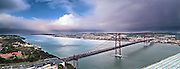 Lisbon, November 2012. Panoramic view of Lisbon and April 25 bridge (United States Steel Export Company, 1966) and Tagus estuary and mouth, from Christ the King monument in Almada.