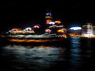 """This picture fooled me for a long time.  I originally thought that this was a picture of another ferry as we crossed paths in Aberdeen Bay as we approached Hong Kong island.  Years later, I realizd it's a picture of the buildings and hotels on Hong Kong Island.  How the buidings on the shore are so """"crisp, yet blurred,"""" and the water is crystal clear still stumps me.  I do think this series is pretty darn psychedelic.  24"""" x 18"""".  Printed on Parrot Digigraphic Photo Gloss paper.  Limited Edition of 25."""