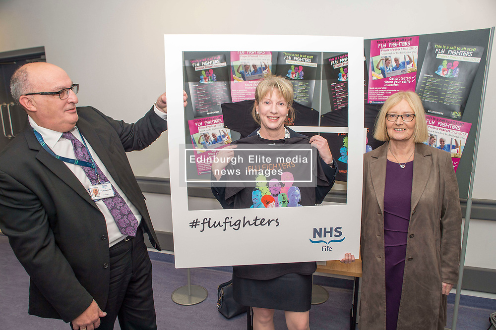 Scottish Health Secretary Shona Robison joins NHS Fife Chief Executive Paul Hawkins and Chair of NHS Fife Tricia Marwick in their Flu Fighters campaign during a visit to the Victoria Hospital in Kirkcaldy.<br /> <br /> © Dave Johnston/ EEm