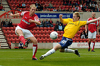 Photo: Henry Browne.<br /> Swindon v Nottingham Forest. Coca Cola League 1.<br /> 13/08/2005.<br /> Patrick Collins of Swindon clears the ball from Forest's Ross Gardner.