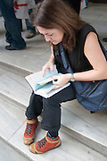 Turkey, Istanbul, Lost Female tourist consulting a guide book