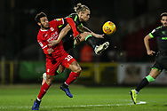 Forest Green Rovers Joseph Mills(23) beats Swindon Town's Keshi Anderson(10) to the ball during the EFL Sky Bet League 2 match between Swindon Town and Forest Green Rovers at the County Ground, Swindon, England on 12 February 2019.