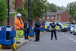 """© Licensed to London News Pictures. 02/06/2021. Aylesbury, UK. Police at the scene following a fatal incident, believed to involve an electrical worker, in Fairford Leys Way, Aylesbury. South Central Ambulance Service (SCAS) were called at 11:30am and sent a rapid response vehicle, ambulance crew, ambulance o fficer and the Thames Valley Air Ambulance to assist one patient. A Thames Valley Police spokesperson said: """"This was the sudden death of a man in Fairford Leys Road, Aylesbury, which was reported at around 11.40am today (2/6). Officers attended along with paramedics. Next of kin have been made aware and are being supported. The death is not being treated as suspicious."""" Photo credit: Peter Manning/LNP"""
