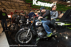 A retro looking motorcycle on display in the Kawasaki booth during EICMA, the largest international motorcycle exhibition in the world. Milan, Italy. November 20, 2015.  Photography ©2015 Michael Lichter.