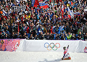 Specators cheer as Vic Wild of Russia finishes his gold medal run in men's snowboard parallel slalom at the Rosa Khutor Extreme Park during the Winter Olympics in Sochi, Russia, Saturday, Feb. 22, 2014. (Brian Cassella/Chicago Tribune/MCT)