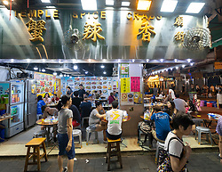 Typical seafood restaurant on famous Temple Street night market in Kowloon, Hong Kong.
