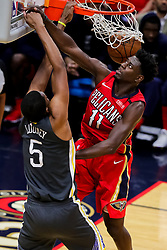 May 6, 2018 - New Orleans, LA, U.S. - NEW ORLEANS, LA - MAY 06:  Golden State Warriors forward Kevon Looney (5) dunks the ball against New Orleans Pelicans guard Jrue Holiday (11) during game 4 of the NBA Western Conference Semifinals at Smoothie King Center in New Orleans, LA on May 06, 2018.  (Photo by Stephen Lew/Icon Sportswire) (Credit Image: © Stephen Lew/Icon SMI via ZUMA Press)