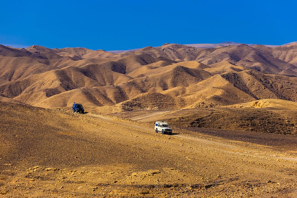 Jeeps traverse the Metzoke Dragot, an area in the Judean Desert near the Dead Sea, Israel.