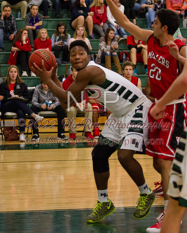 #1 Z'Quan Hogan passing the ball in the paint.