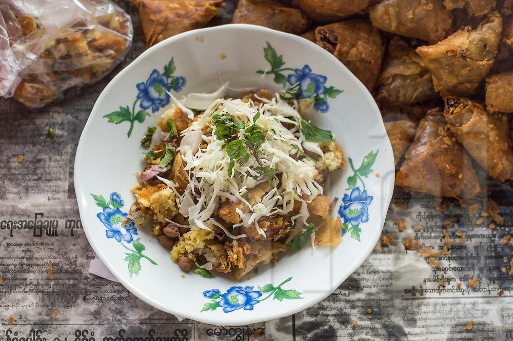 Traditional burmese street food samosa thoke, Yangon, Mynamar, Southeast Asia
