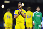 Scott Wagstaff (7) of AFC Wimbledon applauds the travelling fans at full time after Wimbledon lost 2-0 to Bristol Rovers during the EFL Sky Bet League 1 match between Bristol Rovers and AFC Wimbledon at the Memorial Stadium, Bristol, England on 23 October 2018.