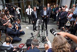 © Licensed to London News Pictures. 18/07/2018. London, UK. A lawyer for SIR CLIFF RICHARD reads a statement to the media as he leaves the Rolls Building of the High Court in London where judges ruled in favour of a claim by Sir Cliff Richard for damages against the BBC for loss of earnings. The 77-year-old singer sued the corporation after his home in Sunningdale, Berkshire was raided following allegations of sexual assault made to Metropolitan Police. Photo credit: Ben Cawthra/LNP