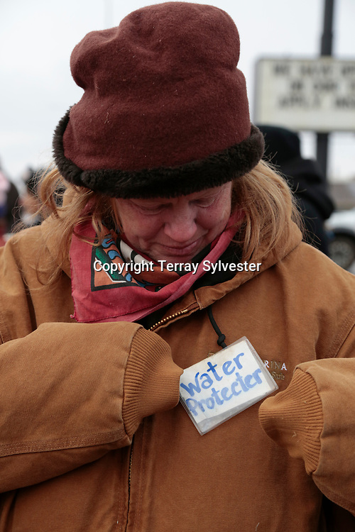 Marston Blow from Asheville, North Carolina, adjusts her credentials during a protest against the Dakota Access oil pipeline on Thanksgiving Day, November 24, 2016. Mandan, North Dakota, United States.