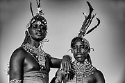 Samburu warriors with long hair covered in goat fat and ochre standing on a hilltop overlooking Lake Turkana, black and white,Lake Turkana, Loiyangalani,Kenya, Africa