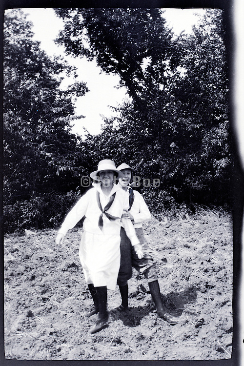 two young adult women having a fun time 1920s rural USA
