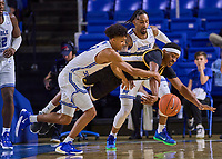 Middle Tennessee Blue Raiders guard Donovan Sims (3), Southern Miss Golden Eagles forward Leonard Harper-Baker (32) and Middle Tennessee Blue Raiders guard Antonio Green (55) chase a loose ball during the Southern Mississippi Golden Eagles at Middle Tennessee Blue Raiders college basketball game in Murfreesboro, Tennessee, Saturday, March, 7, 2020.<br /> Photo: Harrison McClary/All Tenn Sports