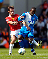 Fotball<br /> Foto: SBI/Digitalsport<br /> NORWAY ONLY<br /> <br /> Blackburn Rovers v Manchester United<br /> Barclays Premiership, 28/08/2004<br /> <br /> Blackburn's Dwight Yorke (R) makes a substitute appearance against his former club, as Manchester United's Gary Neville extends a warm welcome.