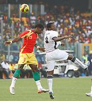 Photo: Steve Bond/Richard Lane Photography.<br />Ghana v Guinea. Africa Cup of Nations. 20/01/2008. Asamoah Gyan (R) heads the ball past Oumar Kalabane (L)